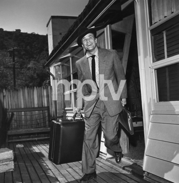 Marlon Brando leaving his Beverly Glen home in Los Angeles on a trip to New York1953 © 1978 Sid Avery - Image 0007_0016