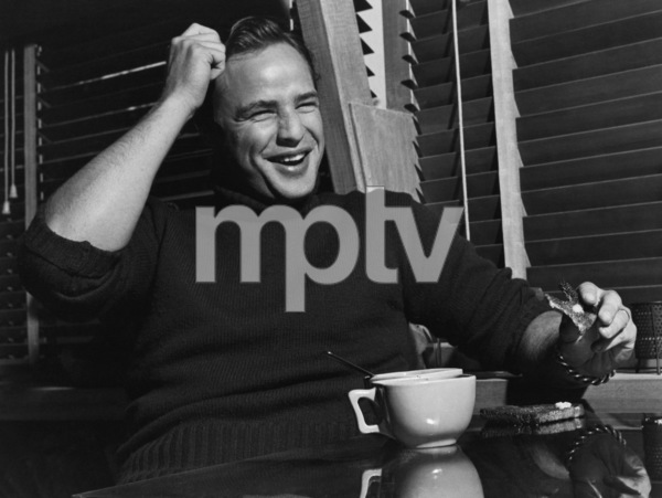 Marlon Brando eating toast at his Beverly Glen home in Los Angeles 1953 © 1978 Sid Avery - Image 0007_0020