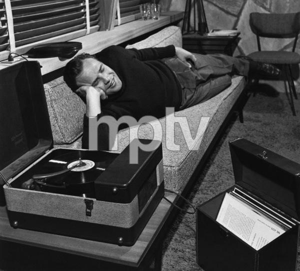 Marlon Brando listening to a record at his Beverly Glen home in Los Angeles 1953 © 1978 Sid Avery - Image 0007_0043