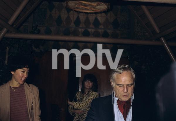 Marlon Brando and Yachio Tsubaki coming out of Trader Vic