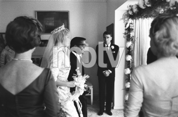 Sammy Davis Jr. and May Britt on their wedding day as Peter Lawford stands in the backgroundNovember 1960 © 1978 Bernie Abramson - Image 0009_0509
