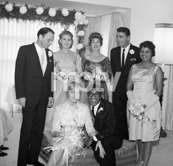 Sammy Davis Jr. and May Britt on their wedding day (Frank Sinatra, Luddy Waters and Peter Lawford behind, Shirley Rhodes on the far right) 1960 © 1978 Bernie Abramson - Image 0009_0514