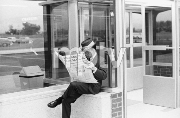 Frank Sinatra reading the San Francisco Chronicle at the airportcirca 1950s© 1978 Bernie Abramson - Image 0009_2370