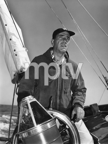 "Humphrey Bogart at the helm of his yacht ""Santana""1952© 1978 Sid Avery - Image 0015_0003"