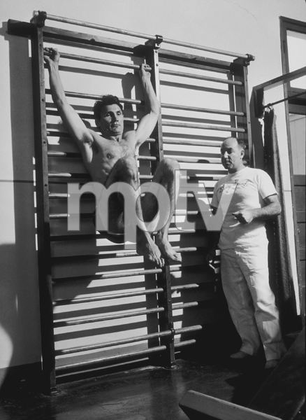 Jack Palance working out with Hollywood trainer, Terry Hunt, 1954. © 1978 Sid Avery MPTV - Image 0021_0303