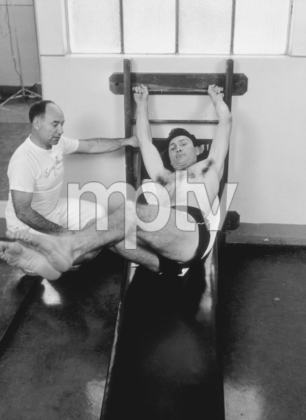 Jack Palance wokring out with Hollywood trainer, Terry Hunt, 1954. © 1978 Sid Avery MPTV - Image 0021_0304