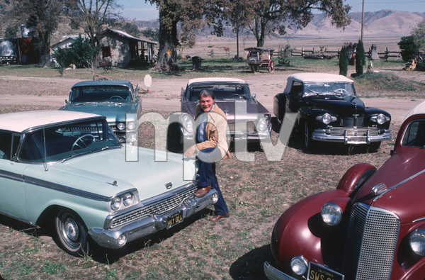 Jack Palance with a 1959 Ford, 1959 Cadillac,1958 Lincoln Continental Mark 3 Convertible,1942 Lincoln Continental Cabriolet ,and a 1937 Cadillac.  1982.. - Image 0021_0444