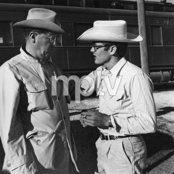 """James Dean and director George Stevens on location for """"Giant"""" in Marfa, Texas1955© 1978 Sid Avery - Image 0024_0017"""
