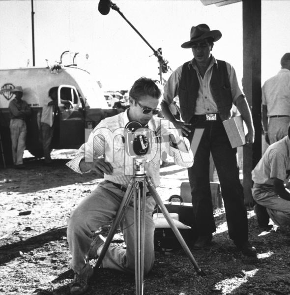 """James Dean and his Bolex camera on location for """"Giant"""" in Marfa, Texas, 1955. © 1978 Sid Avery - Image 0024_0022"""