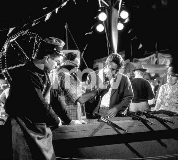 "James Dean preparing for carnival shooting range scene in ""East of Eden.""1955 Warner / MPTVPhoto by Floyd McCarty - Image 0024_0253"