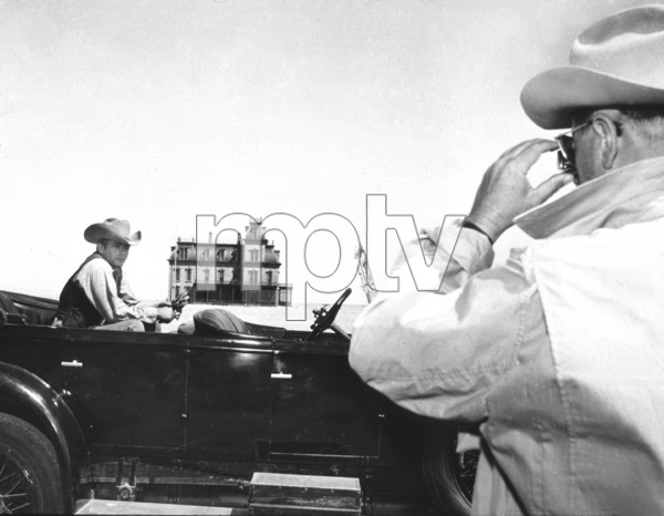 """James Dean and Director George Stevenson the set of """"Giant"""" in Marfa, Texas.1955 Warner / MPTVPhoto by Floyd McCarty - Image 0024_0452"""