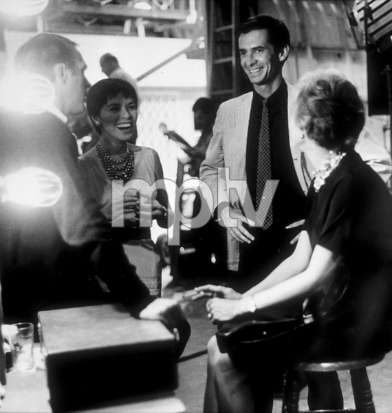 """Anthony Perkins with Steve McQueen, his wife Neile Adams, and Janet Leigh behind the scenes of """"Alfred Hitchcock Presents"""" (Episode: Man from the South) 1959 © 1978 Sid Avery - Image 0032_0005"""
