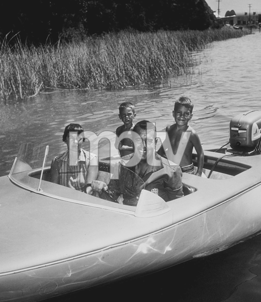 Tennessee Ernie Ford with his wife, Betty, and sons, Brion and Jeffery, on a boat at their ranch in Clear Lake, CA, 1957. © 1978 Sid Avery MPTV - Image 0064_0033