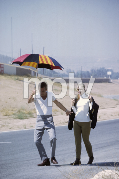 """Paul Newman with wife Joanne Woodward on location at Riverside Raceway in California for the filming of """"Winning""""1968© 1978 David Sutton - Image 0070_2354"""