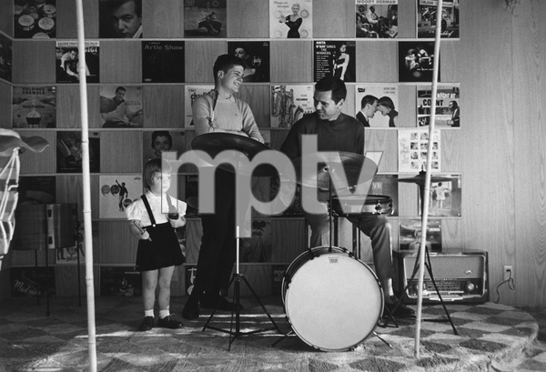 Jackie Cooper playing the drums as daughter Julie and son John Anthony look on1961 © 1978 Sid Avery - Image 0078_0013