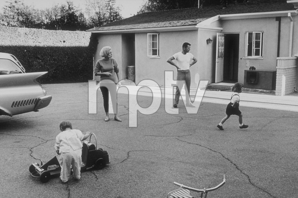 Jackie Cooper with his wife, Barbara, and daughters, Christina and Julie, at home in Brentwood, CA, 1961. © 1978 Sid Avery MPTV - Image 0078_0015