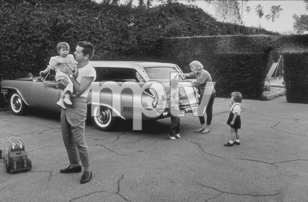 Jackie Copper with his wife, Barbara, and children, Christina, Russell, and Julie, at home in Brentwood, CA, 1961. © 1978 Sid Avery MPTV - Image 0078_0018