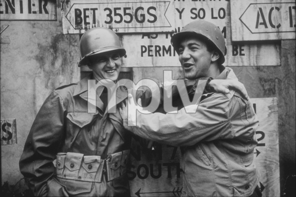 """Bob Newhart and Bobby Darin filming """"Hell is for Heroes"""" at Paramount Studios, 1961. © 1978 Sid Avery MPTV - Image 0092_0819"""