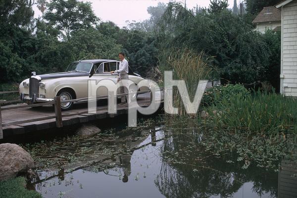 EFREM ZIMBALIST Jr. AT HOME IN ENCINO CA, WITH HIS 1959 BENTLEY, 1971. © 1978 GENE TRINDL - Image 0286_0750