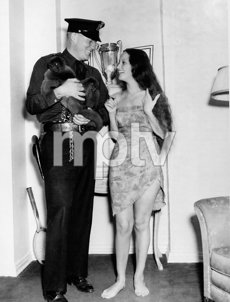 Dorothy Lamourwith Patrolman A.H. Wingerter and her monkey UlahOctober 2, 1936 - Image 0316_0047