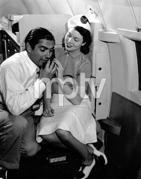 Tyrone Powe next to a stewardessc. 1940