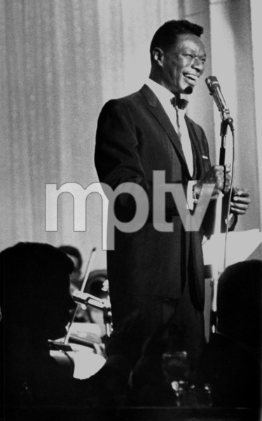 Nat King Cole during a performace with President John F. Kennedy in the audience (in silhouette)c. 1961 © 1978 David Sutton - Image 0321_0051