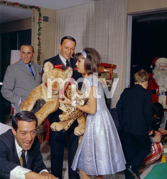 Frank Sinatra gives Christmas gifts to Nancy at homecirca 1966© 1978 Ted Allan - Image 0337_0783