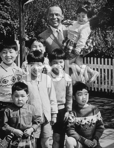 Frank Sinatra visits Japanese orphans on his children