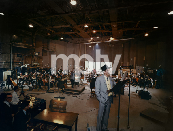 "Frank Sinatra, Nelson Riddle and 73 musicians on stage 7 of the Samuel Goldwyn Studios in Hollywood recording the album ""The Concert Sinatra""  (this photo would make the 1963 record album's cover)1963© 1978 Ted Allan - Image 0337_1993"