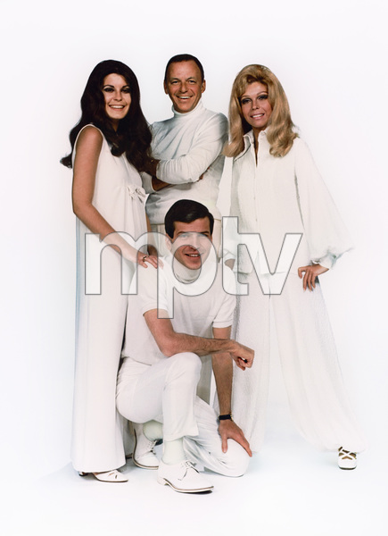 "Frank Sinatra with children Nancy Sinatra, Tina Sinatra and Frank Sinatra Jr. posing for ""The Sinatra Family Wish You a Merry Christmas"" album cover 1969  © 1978 Ed Thrasher - Image 0337_2071"