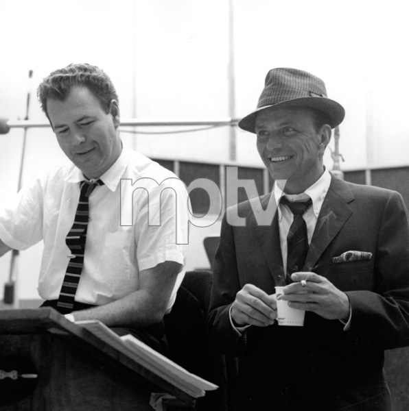 dc55b757 Frank Sinatra and arranger Nelson Riddle at a Capitol Records recording  session, c. 1959