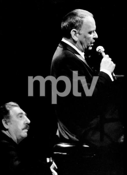 Frank Sinatra and Al Viola performing at Caesar
