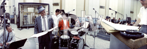 Frank Sinatra and Dean Martin (background) during a recording sessioncirca 1964 © 1978 Ted Allan - Image 0337_2399