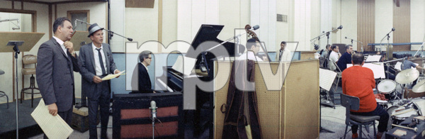 Frank Sinatra, his longtime pianist Bill Miller at the piano (right) and arranger Nelson Riddle (left) during a recording session circa 1964 © 1978 Ted Allan - Image 0337_2402