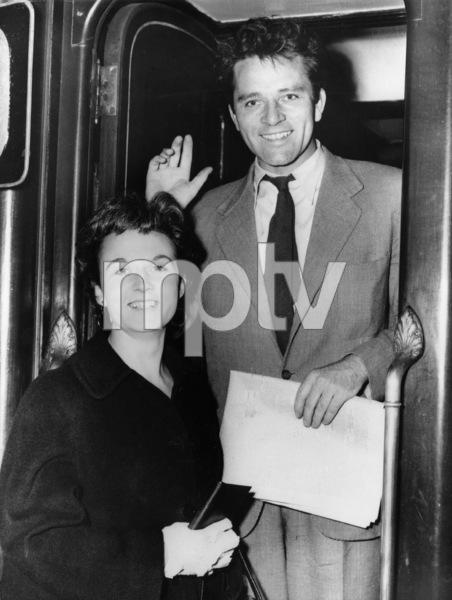 British film star Richard Burton and his wife, Sybil, make farewells at London