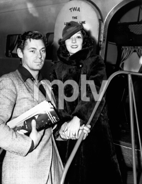 Johnny Weissmuller at the airport in California to see Lupe Velez, his wife, off on the trip to New York12-09-1935 - Image 0579_0134
