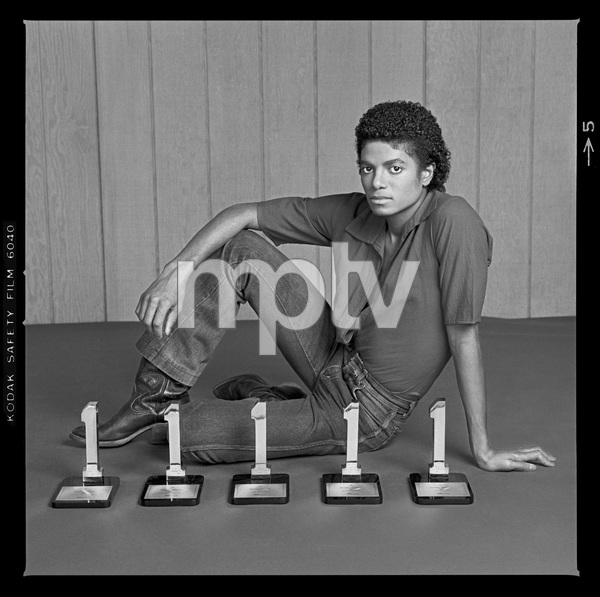 "Michael Jackson in Los Angeles with his five Billboard Magazine awards for the album ""Off the Wall"" (#1 Pop Singles Artist, #1 Pop Album, #1 Soul Artist, #1 Soul Album, #1 Soul Singles Artist)1980 © 2009 Bobby Holland - Image 0628_0021"
