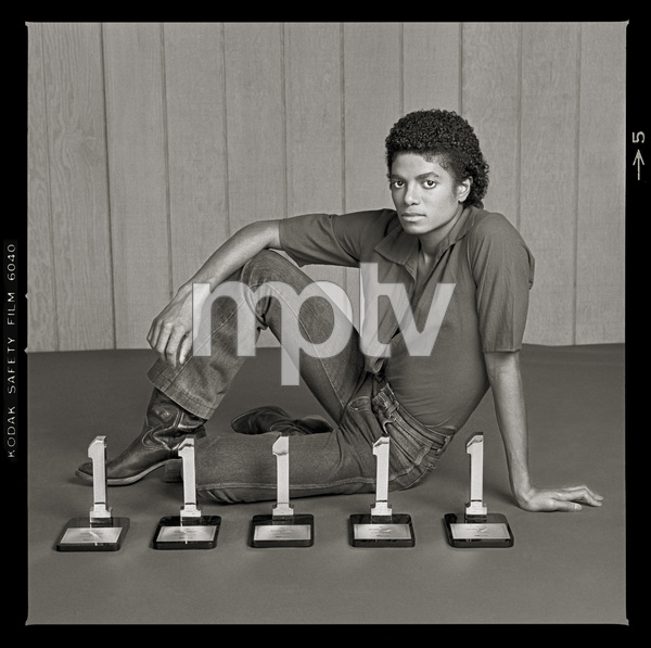 """Michael Jackson in Los Angeles with his five Billboard Magazine awards for the album """"Off the Wall"""" (#1 Pop Singles Artist, #1 Pop Album, #1 Soul Artist, #1 Soul Album, #1 Soul Singles Artist)1980 © 2009 Bobby Holland - Image 0628_0021b"""