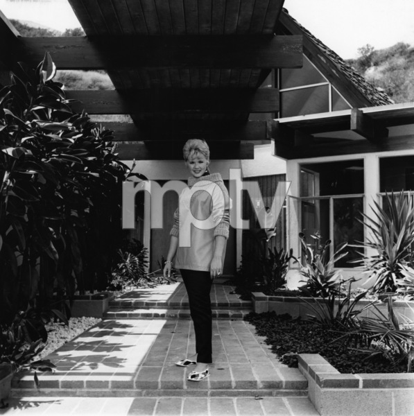 Connie Stevens in front of her new homecirca 1960sPhoto by Joe Shere - Image 0658_0155