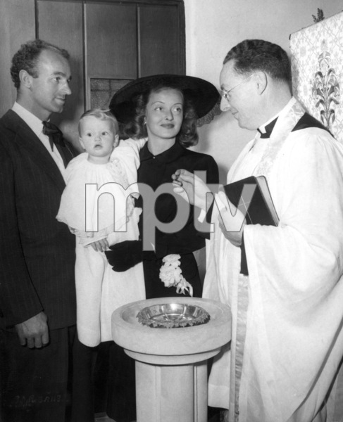 Bette Davis with husband William Grant Sherry and daughter barbara, during her christening, 1948. - Image 0701_0060