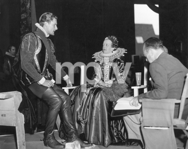 """""""The Private Lives Of Elizabeth And Essex,"""" 1939.Errol Flynn, Bette Davis, Dialogue Director Stanley Logan.Photo by Bert Six - Image 0701_0295"""