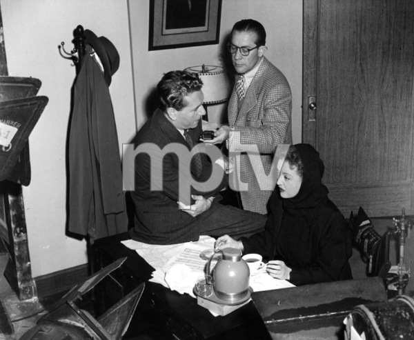 "Bette Davis with Paul Henreid and Cameraman Ernie Haller on set of ""Deception,"" 1946.Photo by Frank Bjerrring - Image 0701_0311"