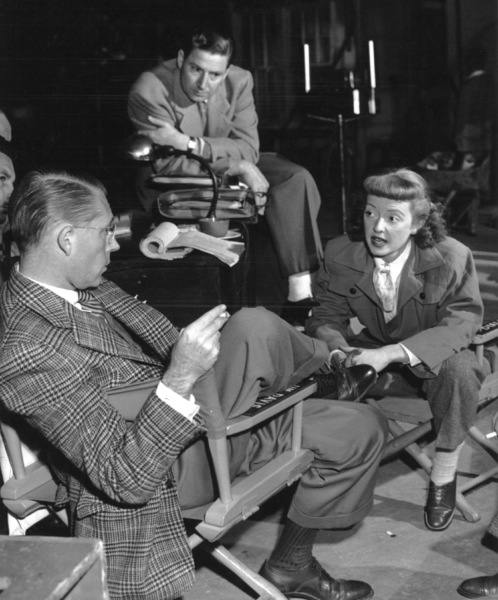 "Bette Davis and Dir. Bretaigne Winduston the set of ""Winter Meeting,"" 1948.Photo by Morgan - Image 0701_1362"