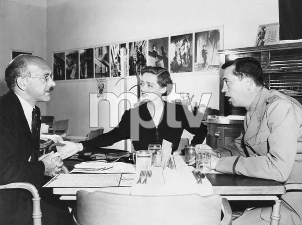 Bette Davis with Herman Shumlin and John Huston at WB Green Room, 1942, I.V. - Image 0701_2248