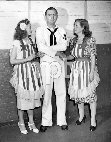 """Bette Davis with Helen Menken and Seaman Second Class Robert B. Winkler, at """"Stage Door Canteen"""" radio broadcast, 1943, I.V. - Image 0701_2249"""