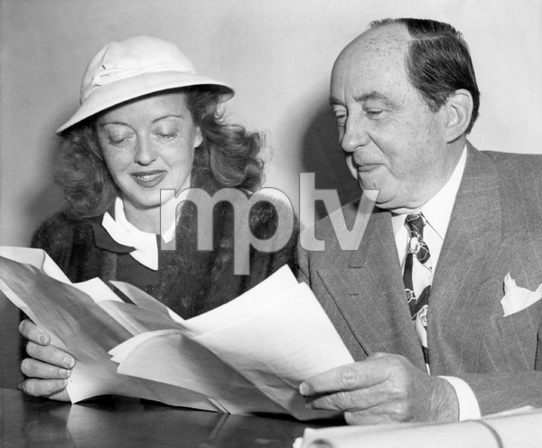 Bette Davis with her attorney Jerry Giesler during trial for custody of her daughter, 1940