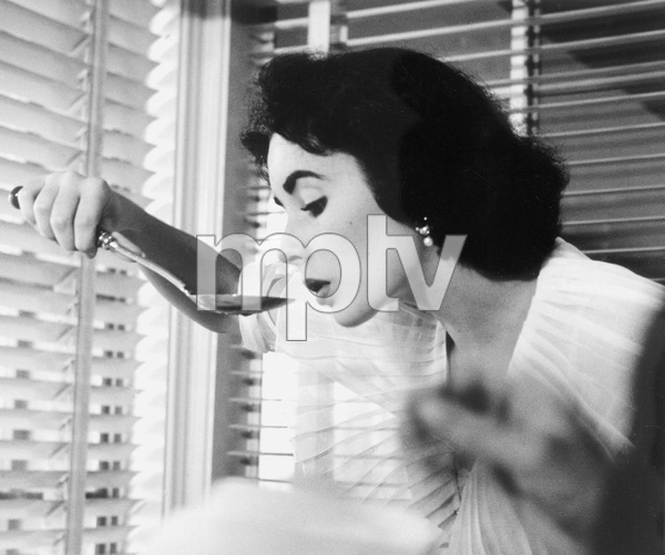 Elizabeth Taylor at a baby shower given by her and Barbara Thompson for Marilyn Hilton1950 © 1978 Bob Willoughby - Image 0712_5182