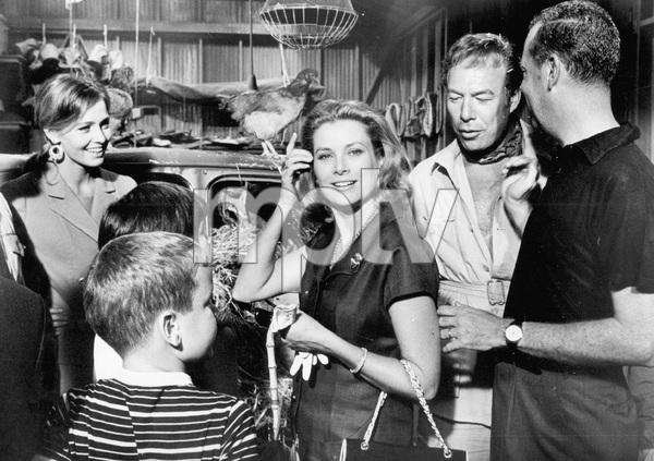 Grace Kelly (center) L to R Eva Renzi, Prince Albert,Princess Caroline, George Kennedy, & Dir. Delbert Mann1967 Hollywood - Image 0724_0422