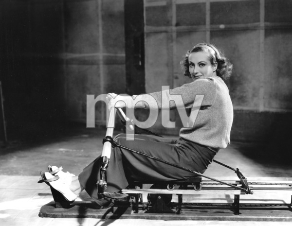 Joan Crawford exercising on a rowing machineMGM, 1933**I.V. - Image 0728_8321