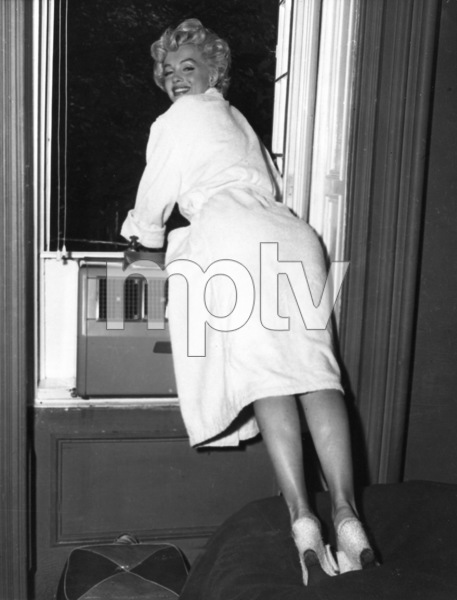 "Marilyn Monroe greeting fans gathere outside ofthe window in NY during filming of ""The SevenYear Itch,"" 1954. - Image 0758_0791"